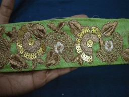 Pistachio Green and Gold Embroidered designer Trims on with sequences This beautiful Lace can be used for designing stylish blouses shrugs skirts tunics festive wear wedding wear and dresses