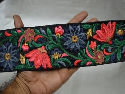 Coral Decorative Embroidered Trim On Black Silk Fabric