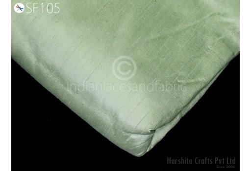 Indian dupioni silk fabric in pistachio green color