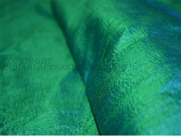 Silk dupioni fabric has a brilliant sheen Green and Peacock Blue
