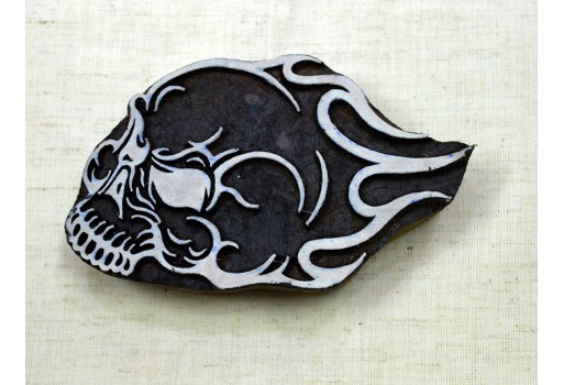 Carved skull in flames wooden block design