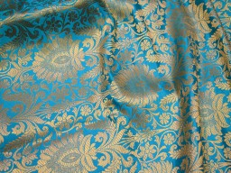 Blended silk brocade floral design fabric in Turquoise Blue and Gold