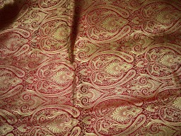 Blended silk brocade floral design fabric in Maroon and Gold