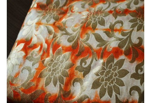 Silk Brocade Fabric in Beige, Orange and Gold motifs Pattern