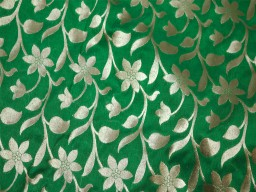 Banarasi blended silk brocade illustrate motifs pattern golden weaving design fabric green background brocade wholesale fabric by the yard kids dress material hat making fabric home furnishing brocade trousers fabric bow-tie