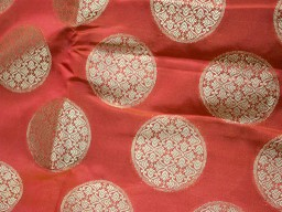 Blended silk brocade floral  design fabric in Red and Gold brocade
