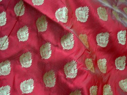 Brocade design in Iridescent Maroon White and Gold silk fabric