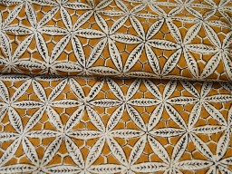 Pure cotton fabric in Mustard block print has floral motifs printed on beige base
