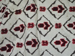 Fabric in block printed flowers in Grey Maroon