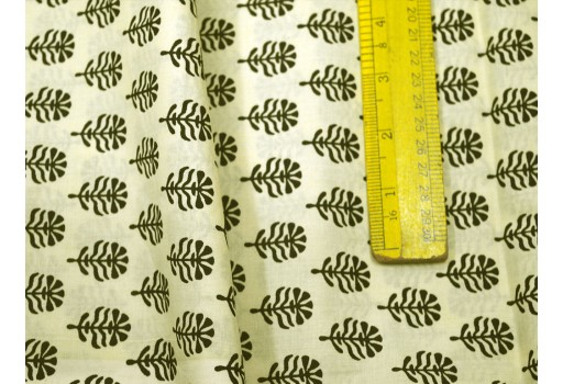 Beautiful motifs in black are printed over lime yellow background
