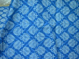 Beautiful motifs in White are printed over Blue background Quilt cotton bohemian fabric