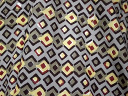 Pure cotton fabric has block print in black geometrical printed