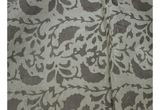 Block print floral design in Brownish-grey on Beige base