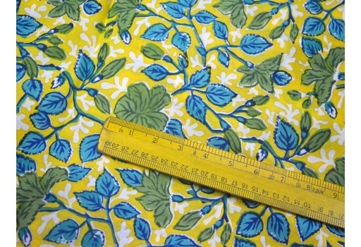 Beautiful floral motifs in Seaweed Green Blue Yellow are print cotton