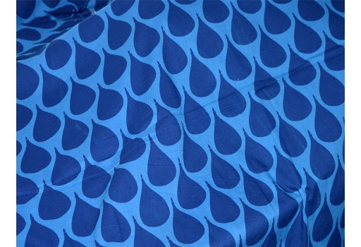 Features Leaves Pattern print in Blue Color on cotton fabric for summer dresses